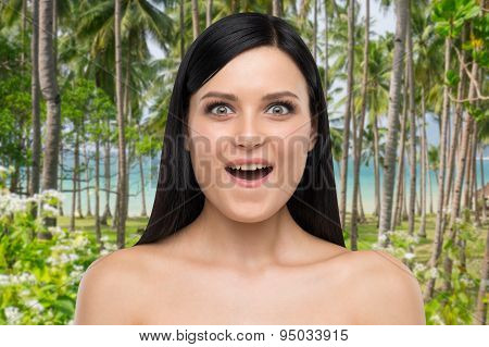 Portrait Of An Astonished Brunette Girl. Tropical Background.