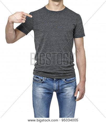 Close-up Of A Man Pointing His Finger On A Blank Grey T-shirt. Isolated.