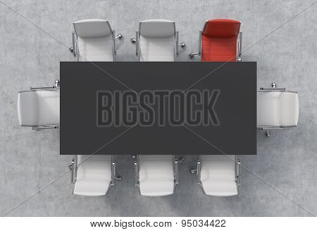 Top View Of A Conference Room. A Black Rectangular Table And Eight Chairs Around, One Of Them Is Red