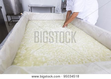Cheese Worker Over Tank In A Diary Creamery