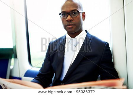 Close Up Young Businessman Commuting On A Train