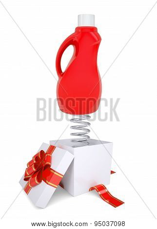 Gift box with red bottle on spring