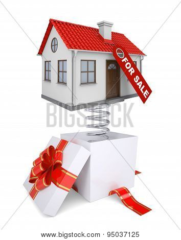 Gift box with red band and house for sale