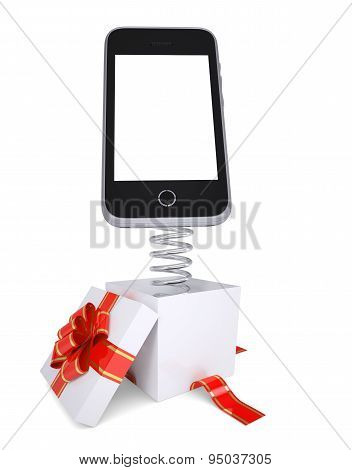 Gift box with red band and smartphone on spring
