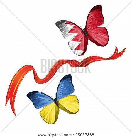 Two butterflies with symbols of Ukraine and Bahrain