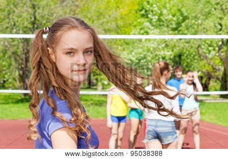 Portrait of turning teen girl during volleyball