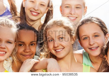 Close-up portrait of teenagers diversity in hug