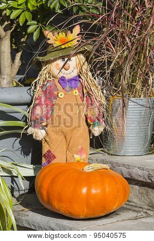 Puppet And Pumpkin Decoration In Autumn