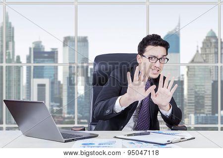 Afraid Businessperon Working At Workplace