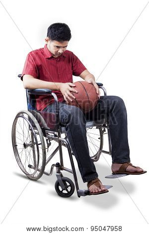Disabled Man Holds Basketball On Wheelchair