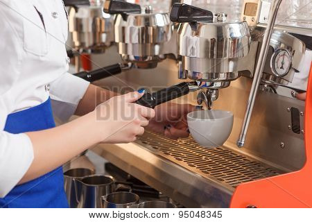 Close-up of barista making coffee