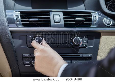 Hand Adjusting The Car Button