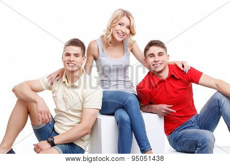 Three friends posing on isolated background