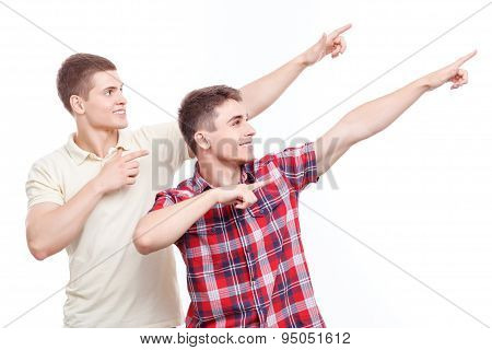 Two handsome men posing on isolated background