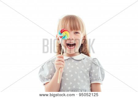 Little laughing girl holding candy