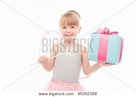 Pleasant little girl holding present