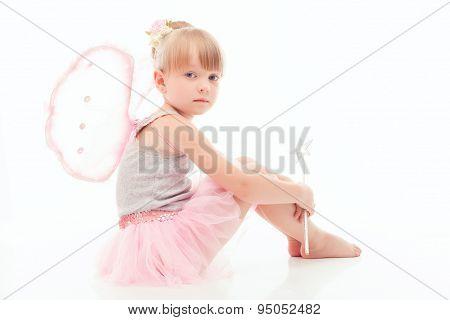 Nice little girl sitting on the floor