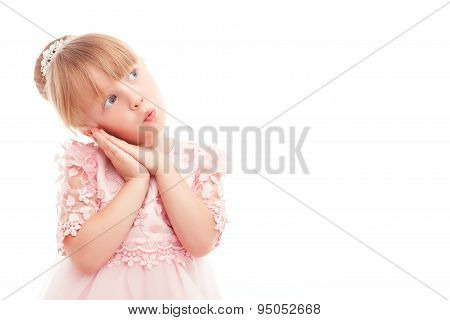 Pretty little girl leaning her head on hands