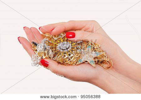 Hands holding expensive gold jewelry