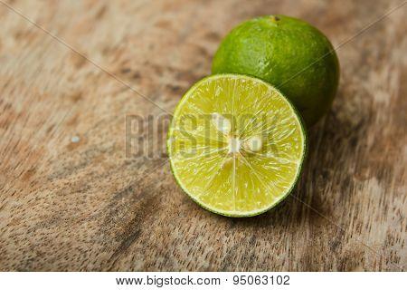 Lemon And Old Wood Background.