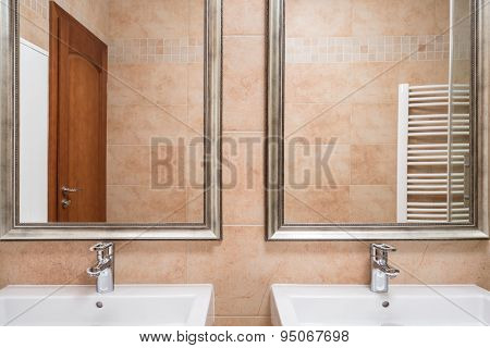 Two Washbasins In Beige Toilet