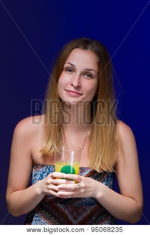 girl drinking a cocktail against blue background