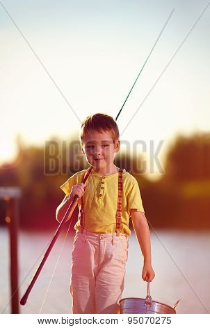 Happy Little Boy Walking After Successful Fishing On The Pond