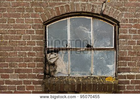 Old Abandoned Window With Broken Glass