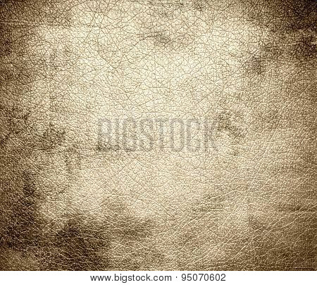 Grunge background of bisque leather texture