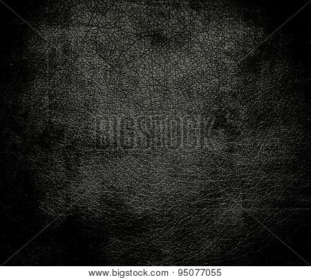 Grunge background of black olive leather texture