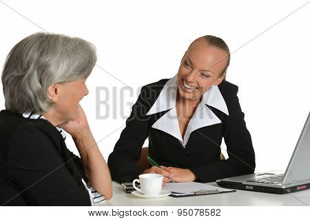 Two businesswomen with coffee and laptop