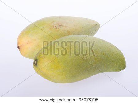 Mangos Or Green Yellow Mangos On Background.