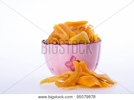 Mango Dry In Bowl Or Dried Mango Slices.