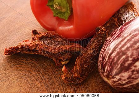 Sun Dried Tomatoes, Red Pepper And Eggplant On A Cutting Board