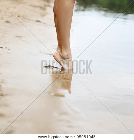 Beautiful Woman Legs. It Should Be In The Water.