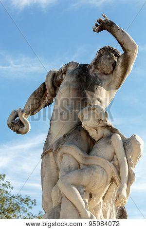 PARIS, FRANCE - SEPTEMBER 9, 2014: Antique sculpture in Jardin des Tuileries (Tuileries garden) - favorite spot for rest of tourists and Parisians. Garden was created by Catherine de Medici in 1564. Paris Franc