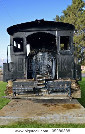 Old black locomotive train engine