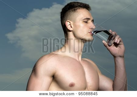 Sexy Bodybuilder With Glass Of Water