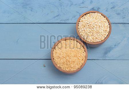 Buckwheat Groats And Rice On The Blue Board