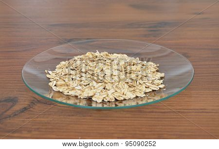 Plate Of Glass With Oat Flakes