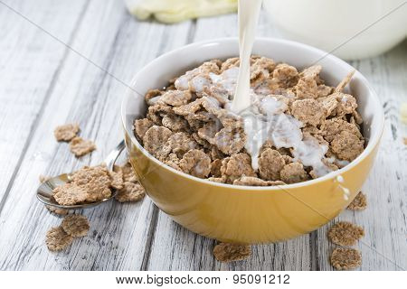Pouring Milk In A Bowl With Cornflakes