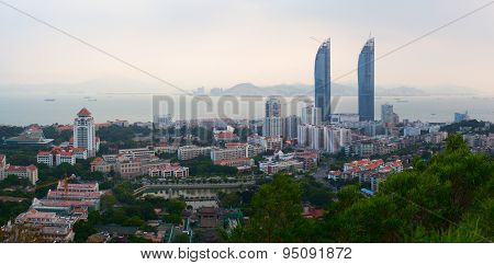 Panoramic view of Xiamen city during evening time from the Wulao Peak
