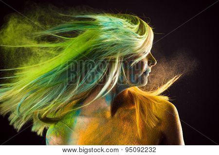 fashion beautiful woman with colorful hair in paint Holi