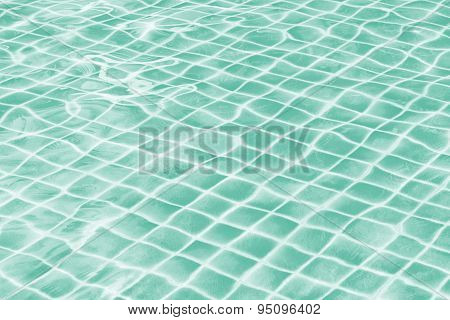 Light Green Jade Swimming Pool Water Texture Reflection.