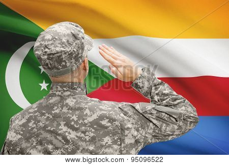 Soldier In Hat Facing National Flag Series - Comoros