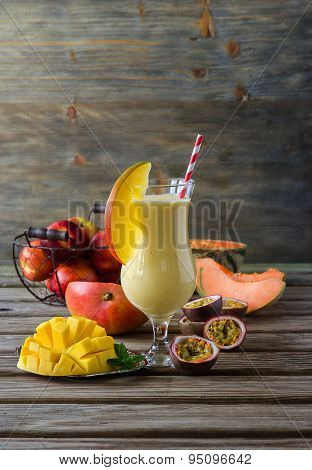 Tropical mango, melon and passion fruit smoothie for healthy breakfast