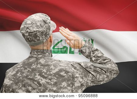 Soldier In Hat Facing National Flag Series - Iraq