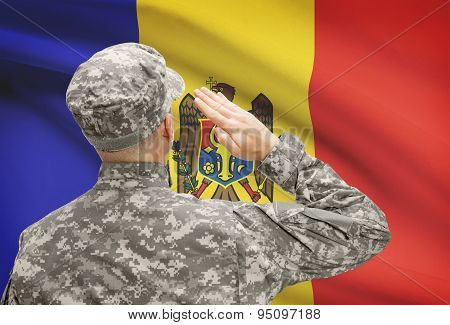 Soldier In Hat Facing National Flag Series - Moldova