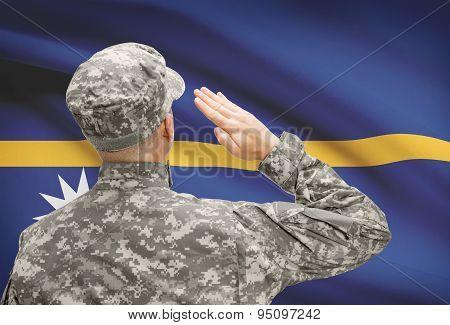 Soldier In Hat Facing National Flag Series - Nauru