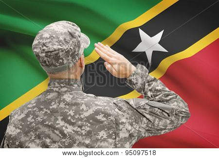 Soldier In Hat Facing National Flag Series - Saint Kitts And Nevis